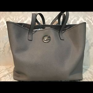Previously loved silver Michael Kors purse